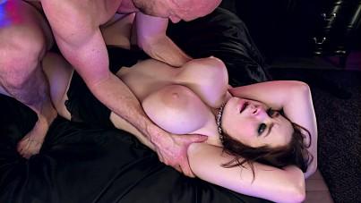 Sliding his cock in between her massive mammaries